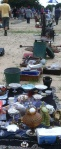 Items are lined up in the dirt at the $10 auction down the street from the auction barn.