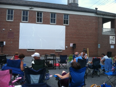 Bring a chair, maybe a picnic, and settle in for a movie projected on the side of the Wine Bin.