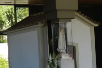 Inside the Chapel of Apparitions, a statue of Mary marks where the three children said the Blessed Mother spoke to them.