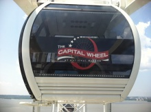 There's room for four, maybe six if two are small, in the nearly all-glass cars of the Capital Wheel.