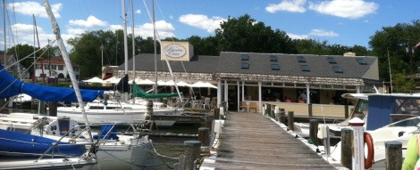 Outside diners at the Pirate Cove enjoy views of all the sailboats and the West River with their drinks or their meal.