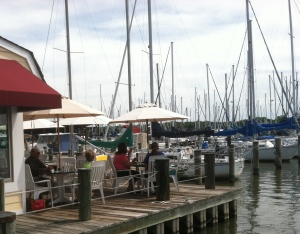Tables on the dock are in high demand on a sunny summer day.