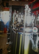 Beer's brewing in the stainless steel kegs right behind the bar.