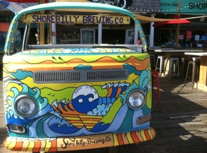 An old VW van parked by the boardwalk points the way to Shorebilly Brewing.