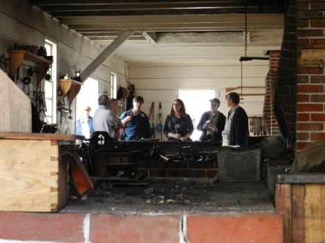 21st Century visitors see the blacksmith's shop in action.