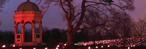 The Maryland monument surrounded by luminaria at the Memorial Illumination.