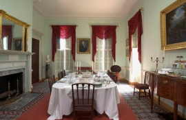 Homewood's dining room in shades of mint green and ruby red.