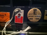 Press passes and badges on display.