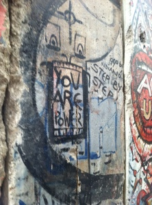 A huge slab of the Berlin Wall, colorful with graffiti on one side and grimly untouched on the other.
