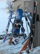 Skis and snowboards await their owners for another trip down the mountain.
