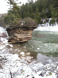 Near Swallow Falls, a giant rock, shaped by the river stands guard in the icy water.