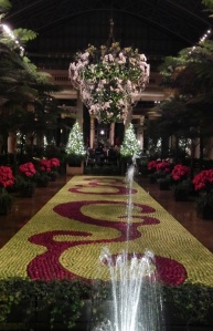 """One """"room"""" of the conservatory at Longwood Gardens.  That red and yellow rug — they are flowers. Breathtaking, isn't it?"""