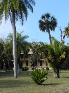 Buildings of the historic settlement are scattered among the palms, ferns and tropical plants from all over the world.