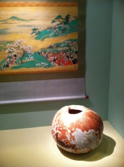 """Shiranase Bunko's painting """"Cherry Blossom Outings"""" has been paired with a vase by Hajashi Shotaro reminiscent of the Tokonoma — a focal point in a Japanese home for displaying things of beauty."""