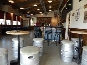 Beer kegs at 16 Mile provide seating in the tasting room.
