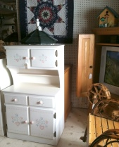 A child-sized hutch and TV cabinet are among the wares for sale at Country Furniture and Crafts.