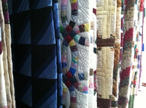 Buy a quilt off the rack or make arrangements to have one made.