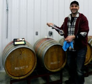 Milan Mladjan , Harvest Ridge's winemaker, offers samples from the barrel during a tour.