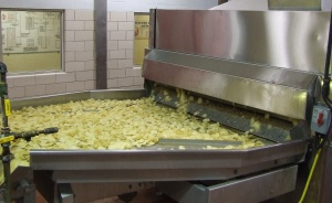 Potato chips fresh from the fryer. Herr's original potato chips remain their best seller.