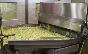 Potato chips fresh from the fryer. Herr's original potato chips remain their best seller.