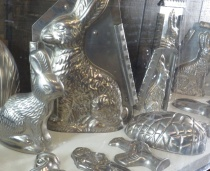 A collection of Easter molds is on display.