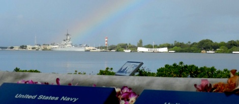 A rainbow appears to end on the deck of the USS Missouri, near the USS Arizona Memorial at Pearl Harbor.