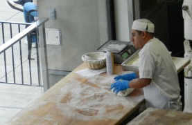The baker can look out the window as he kneads the bread — and passersby can watch as he does it.