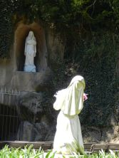 A grotto recalling the Blessed Mother Mary's visits with St. Bernadette in Lourdes is tucked into a hill of the gardens.