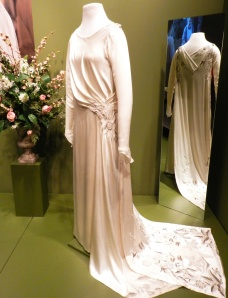 Edith's wedding dress began with a glittering bit of antique fabric that made up her train.