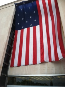 A replica of the flag that flew over Fort McHenry hangs at the entrance of the Smithsonian's National Museum of American History.