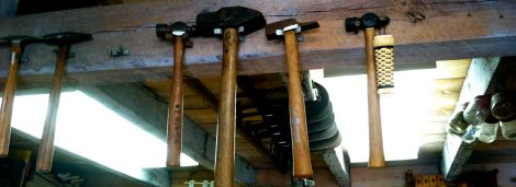 Hammers hang above a workshop at Furnace Town.