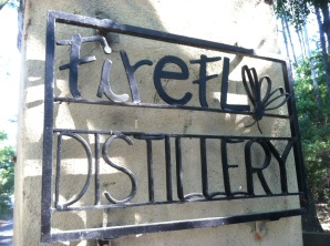 On the right pillar, the distillery sign.