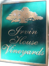 On the left pillar, the vineyard sign.
