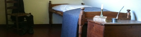 Did Poe sleep here? A tiny bed in a tiny room at the top of a tiny house is here but the question remains unanswered.