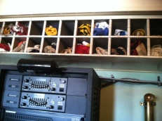 On the bridge is a collection of signal flags, neatly stowed. A modern radio has been installed below.