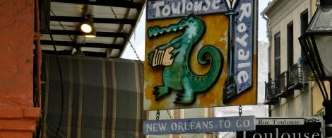 A street corner and a corner shop. Love that alligator.