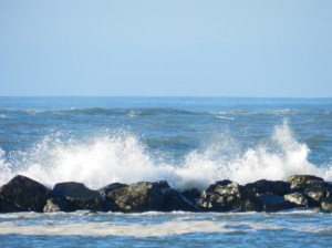 Waves crash along the Assateague shorebreak as the boat leaves the Ocean City Inlet.
