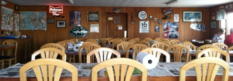 The simple dining room with newspaper covering the tables, paper towels for napkins and a view of the river where the crabs came from.
