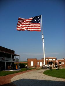 The Star Spangled Banner with its 15 stars and 15 stripes flies over the fort during the day —unless the wind is too strong.