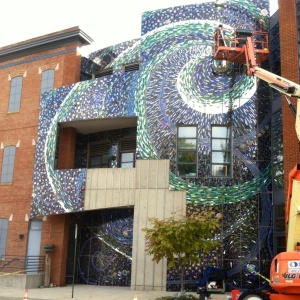 A mosaic, newly installed on AVAM's exterior, has been created by students from a nearby high school, as well as incarcerated youth.