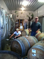 The winemaker at Reid was racking wines while outside zinfandel grapes were being pressed.