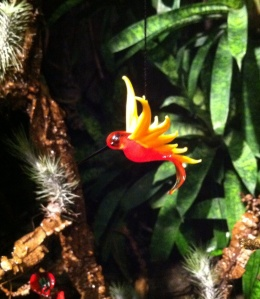 One tropical display features glass bird ornaments.