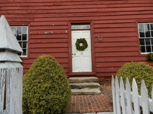 A wreath of vines, greens and fruit adorns the door of the Shiplap House in Annapolis.