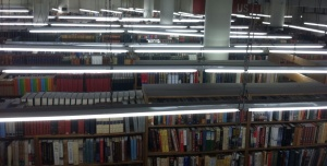 Fluorescent lights illumine shelf after shelf in the Strand.