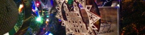 """Side by side on our tree, souvenirs of Austria, Disney World and even good ol' Baltimore. The Austrian woodcut ornament is from the chapel where the von Trapps married in """"The Sound of Music."""""""