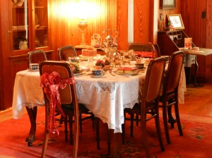 The dining room is set for an elegant party.