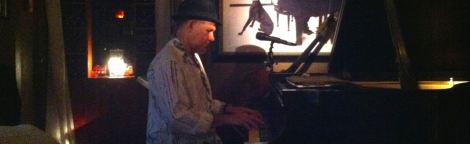 Carli Muñoz at the piano his intimate restaurant in Old San Juan.