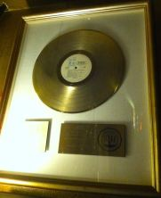 Cali Muñoz hung his gold record for work with the Beach Boys right by the front door.