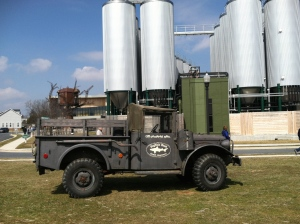 An antique truck bearing Dogfish Head's logo is parked outside the brewery. Those tall towers behind it? They are fermenting tanks, filled with Dogfish Head goodness.
