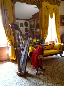 The harp in Hampton's music room figures prominently in a portrait in the main hall.